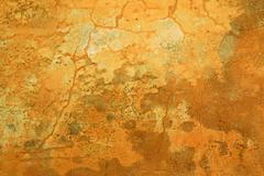 Grungy ochre wall with cracks Stock Photos