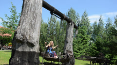 Woman swinging ancient decorative swings antique wooden sleigh Stock Footage