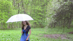 Woman with umbrella dress fruit tree white petals fall garden Stock Footage