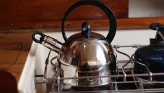 Boiling kettle with whistle - stock footage