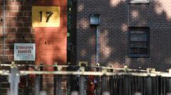 Old metal fence on urban street Stock Footage