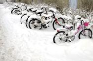Stock Photo of bicycles covered with snow