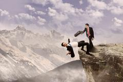 business battle on top of cliff - stock photo