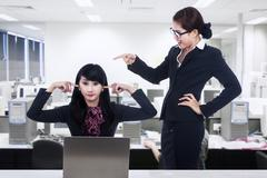 Bussinesswoman bully at office Stock Photos