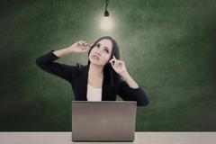 businesswoman think bright idea - stock photo