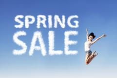 girl jump announce spring sale - stock photo