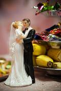 Figures of a newly-married couple on a table Stock Photos