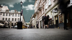 Crowded old city street with time lapse sky. Lviv,Ukraine Stock Footage