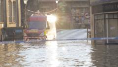 Fire vehicle driving through flood water Stock Footage