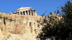 Parthenon, ancient temple and theater ruins under the blue sky Stock Footage