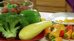 pan to woman cutting yellow pepper - stock footage