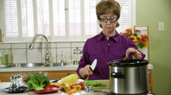 Mature woman working in the kitchen Stock Footage