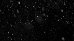 Snow falling aginst black backdrop slow motion 120fps Stock Footage