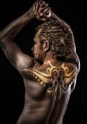 male model with tribal tattoo, evil, blind, fallen angel of death - stock photo