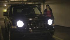 Woman Entering Jeep, Parking Garage - stock footage