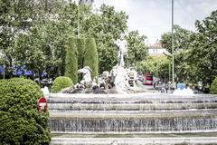 Neptune fountain, image of the city of madrid, its characteristic architectur Stock Photos