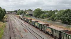 Freight trains pass on the Great Western Main Line at West Drayton, Middlesex - stock footage