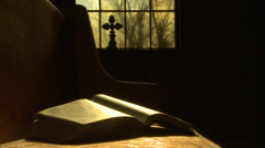 Shot of bibld on pew with window in background - stock footage