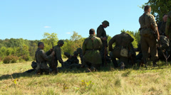 German soldiers rest in shade 3 Stock Footage