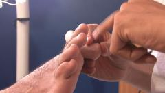 Pedicurist treating the toes Stock Footage