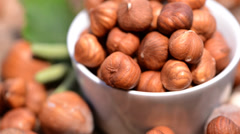 rotating hazelnuts video (loopable) - stock footage