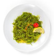 Tasty green algae seaweed isolated on white background Stock Photos