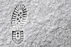 Single footprint in snow Stock Photos