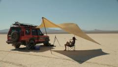 Land Rover Adventure Travel in a Desert with Woman Stock Footage