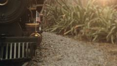 Miniature train passing with American Flag flapping Stock Footage