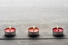 row of burning red tealights - stock photo