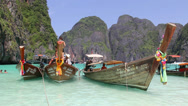 Stock Video Footage of Colorful boats at the beach in Phi Phi island
