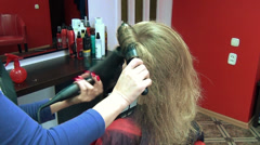 Close hairdresser barber blow dry customer woman hair Stock Footage