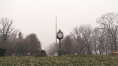 Wide Shot Of The Clock In The Cismigiu Park In Bucharest Stock Footage