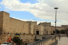 jerusalem, israel - december 9, 2013:  surrounding wall of the old city of je - stock photo