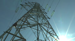Pan through the steel girders of an electricity pylon in France. - stock footage