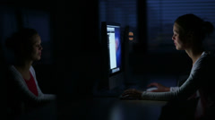 Young female student working alone in a computer classroom Stock Footage
