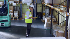Team of industrial workers in a warehouse or factory Stock Footage
