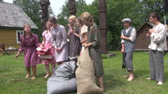 Girls linen colored dresses laugh telling stories to each other Stock Footage