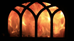 Flames blazing in a cosy fireplace, giving warmth on a cold winter day Stock Footage