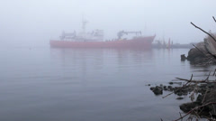 Red loading vessel on quay river in midst of morning Stock Footage
