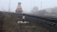 Work train moves on rails paths in fog Stock Footage