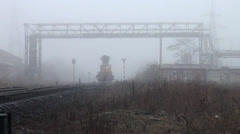 Work train moves on rails paths in fog - stock footage