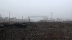 Working res train moves on rails paths in fog Stock Footage