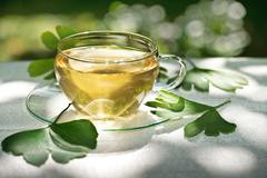 tea with herbaceous plant - stock photo