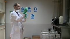Chemical worker with gloves Stock Footage