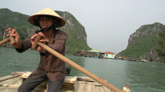 Vietnamese guy rowing the boat with tourist in it Stock Footage
