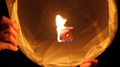 Inside chinese lantern being held and burning Stock Footage