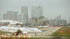 Two Aircraft Taxi On London City Runway - stock footage