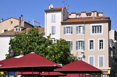 Buildings and sunshades at Antibes in France - stock photo