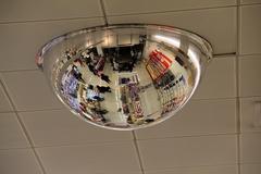 hemisphere mirror on the ceiling - stock photo